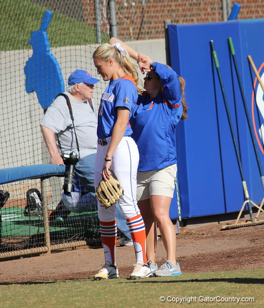Junior Hannah Rogers getting stretched by assistant coach Jennifer Rocha during the Gator's softball game against University of Tennessee on Saturday March 16, 2013, at Katie Seashole Pressly Stadium in Gainesville, Fla. / Gator Country photo by Danielle Bloch