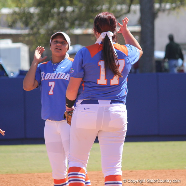 Sophomore Lauren Haeger giving freshman Kelsey Stewart a high-five during the Gator's softball game against University of Tennessee on Saturday March 16, 2013, at Katie Seashole Pressly Stadium in Gainesville, Fla. / Gator Country photo by Danielle Bloch