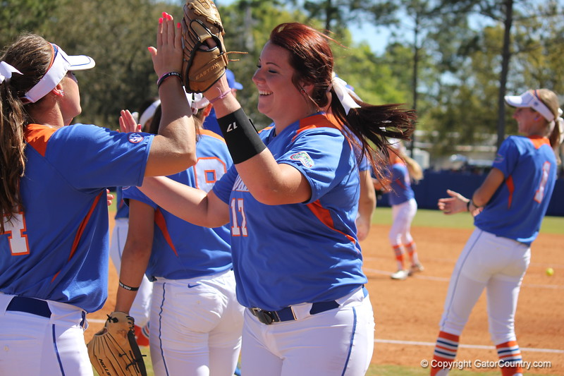 Pitcher Lauren Haeger giving sophomore Jessica Damico a high five after returning to the dugout at the end of the inning during the Gator's softball game against University of Tennessee on Saturday March 16, 2013, at Katie Seashole Pressly Stadium in Gainesville, Fla. / Gator Country photo by Danielle Bloch