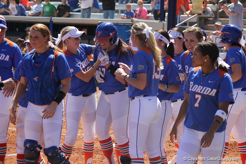 Teammates congratulating Lauren Haeger on her home run during the Gator's softball game against University of Tennessee on Saturday March 16, 2013, at Katie Seashole Pressly Stadium in Gainesville, Fla. / Gator Country photo by Danielle Bloch