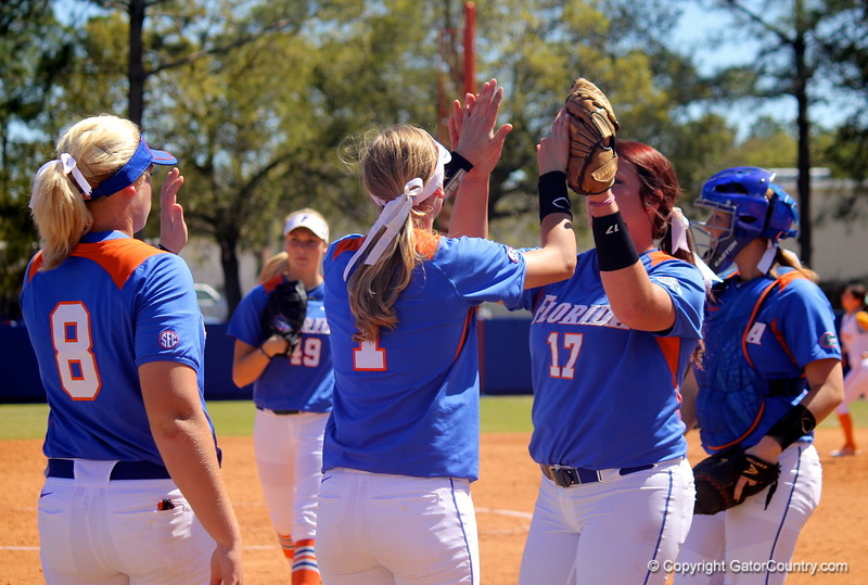 Pitcher Lauren Haeger giving Freshman Aubree Munro a high-five during the Gator's softball game against University of Tennessee on Saturday March 16, 2013, at Katie Seashole Pressly Stadium in Gainesville, Fla. / Gator Country photo by Danielle Bloch