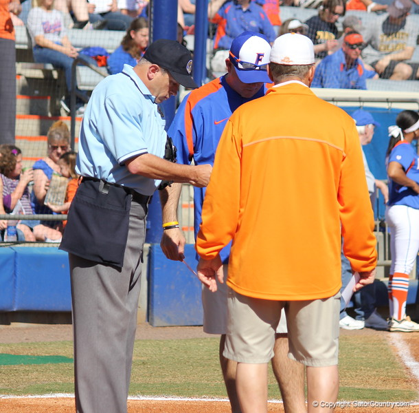 The coaches meeting on home plate before the start of the game during the Gator's softball game against University of Tennessee on Saturday March 16, 2013, at Katie Seashole Pressly Stadium in Gainesville, Fla. / Gator Country photo by Danielle Bloch