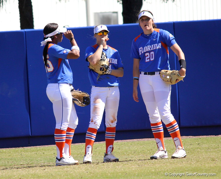Outfielders Briana Little, Kirsti Merritt and Kelsey Horton in between plays during the Gator's softball game against University of Tennessee on Saturday March 16, 2013, at Katie Seashole Pressly Stadium in Gainesville, Fla. / Gator Country photo by Danielle Bloch