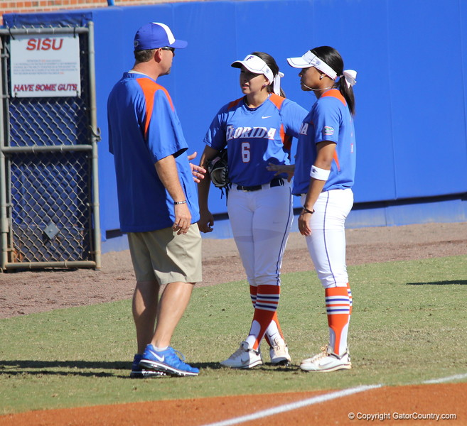 Assistant coach Kenny Gajewski talking with Sophomore Kathlyn Medina freshman Kelsey Stewart during the Gator's softball game against University of Tennessee on Saturday March 16, 2013, at Katie Seashole Pressly Stadium in Gainesville, Fla. / Gator Country photo by Danielle Bloch