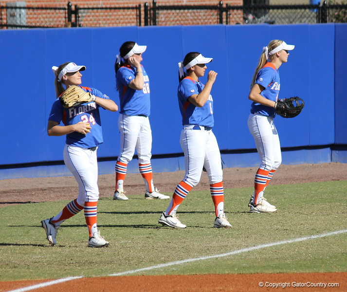 The team warming up during the Gator's softball game against University of Tennessee on Saturday March 16, 2013, at Katie Seashole Pressly Stadium in Gainesville, Fla. / Gator Country photo by Danielle Bloch