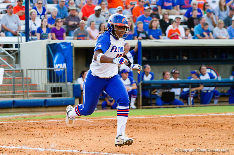 Briana Little attempting to beat out the play at first after an infield hit.