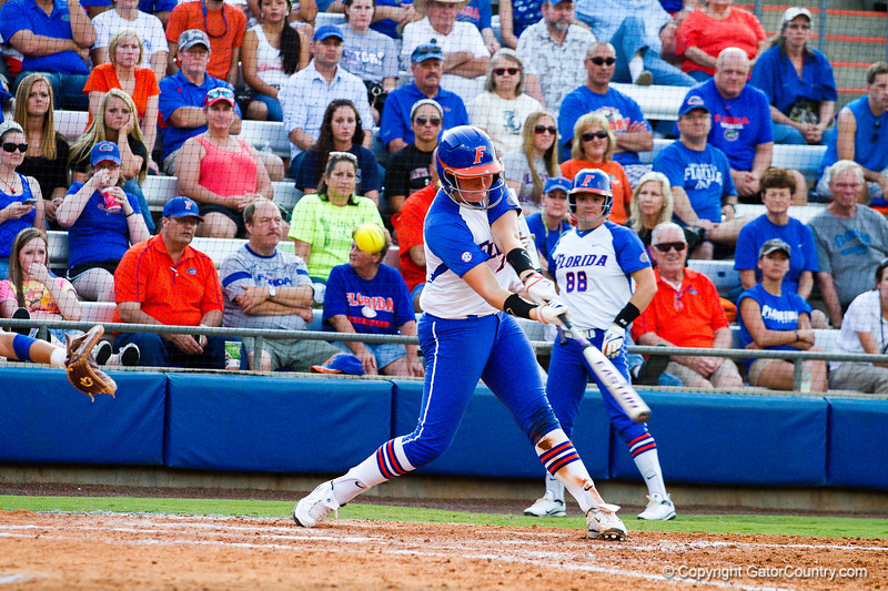 Taylore Fuller takes a big swing against Hampton on May 17, 2013. This was Florida's second home run of the game. Fuller's teammate, Horton, hit the first home run of the game just two batters earlier.