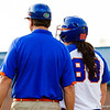 Bailey Castro and coach talk at first base.