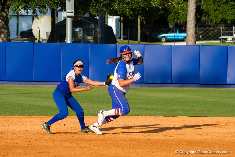 Lauren Haeger is tagged out heading back toward first during the Florida vs Hampton game on May 17, 2013