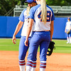 Taylor Schwarz talks with her teammate briefly during the Florida vs Hampton game on May 17, 2013.