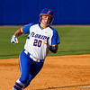 Kelsey Horton heads for third base after teammate Briana Little hit a triple in the bottom of the third inning.