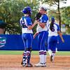 Pitcher Alyssa Bache talks with teammate.