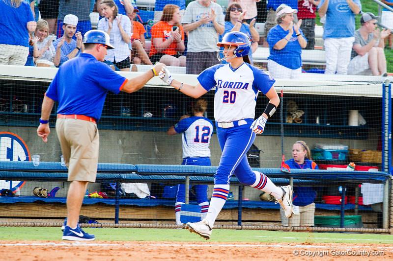 Kelsey Horton celebrates her home run against Hampton on May 17, 2013.
