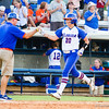 Kelsey Horton celebrates her home run against Hampton on May 17, 2013.