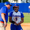 Stephanie Tofft chats with the third base coach in the Florida vs Hampton game on May 17, 2013.