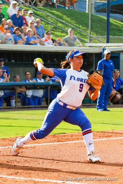 Stephanie Tofft throws to first base in the Florida vs Hampton game on May 17, 2013.