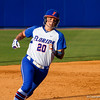 Kelsey Horton rounds second base after teammate Briana Little hit a triple in the bottom of the third inning.