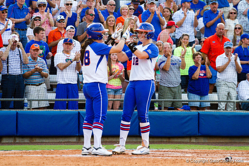 Taylore Fuller and teammate Bailey Castro celebrate Fuller's home run against Hampton on May 17, 2013.