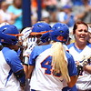 Taylore Fuller and her teammate celebrate her grand slam during Florida's 5-6 loss to Mississippi State on Sunday, April 8th 2013 at the Katie Seashole Pressly Softball Stadium in Gainesville, Florida.