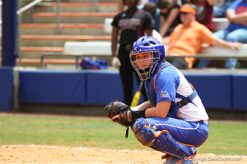 Taylore Fuller looks to her coach for a pitch during Florida's 5-6 loss to Mississippi State on Sunday, April 8th 2013 at the Katie Seashole Pressly Softball Stadium in Gainesville, Florida.