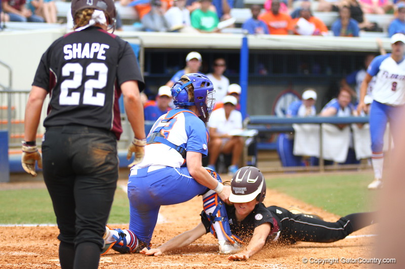 Taylore Fuller makes a play at the plate during Florida's 5-6 loss to Mississippi State on Sunday, April 8th 2013 at the Katie Seashole Pressly Softball Stadium in Gainesville, Florida.