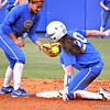 Kelsey Stewart catching the ball while Kelsey Horton slides to second base during the Gators' scrimmage on Tuesday, February 5, 2013 at Katie Seashole Pressly Stadium in Gainesville, Fla.