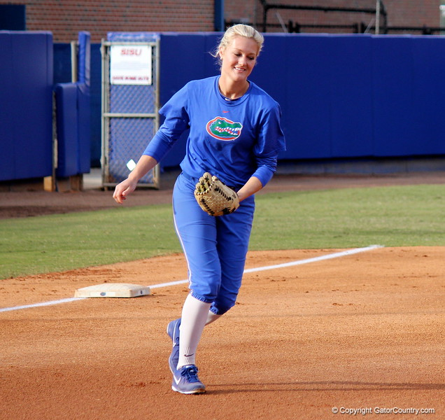 Junior pitcher Hannah Rogers running onto the field at the start of the game during the Gators' scrimmage on Tuesday, February 5, 2013 at Katie Seashole Pressly Stadium in Gainesville, Fla.