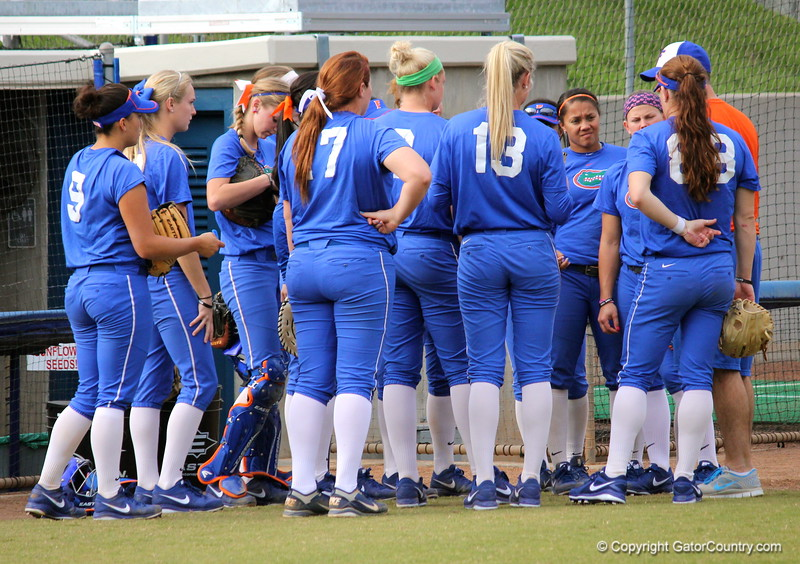 The Gator's softball team huddles with head coach Tim Walton before taking the field during the Gators' scrimmage on Tuesday, February 5, 2013 at Katie Seashole Pressly Stadium in Gainesville, Fla.