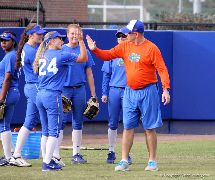 Head coach Tim Walton giving Freshman Kristi Merritt a high-five while warming up at the Gators' scrimmage on Tuesday, February 5, 2013 at Katie Seashole Pressly Stadium in Gainesville, Fla.