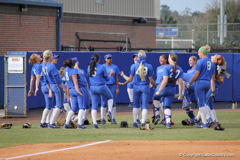 The Gator's softball team in the middle of a pregame ritual during the Gators' scrimmage on Tuesday, February 5, 2013 at Katie Seashole Pressly Stadium in Gainesville, Fla.