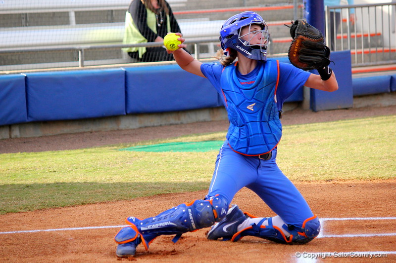 Freshman catcher Aubree Munro throwing the ball back to the pitcher during the Gators' scrimmage on Tuesday, February 5, 2013 at Katie Seashole Pressly Stadium in Gainesville, Fla.