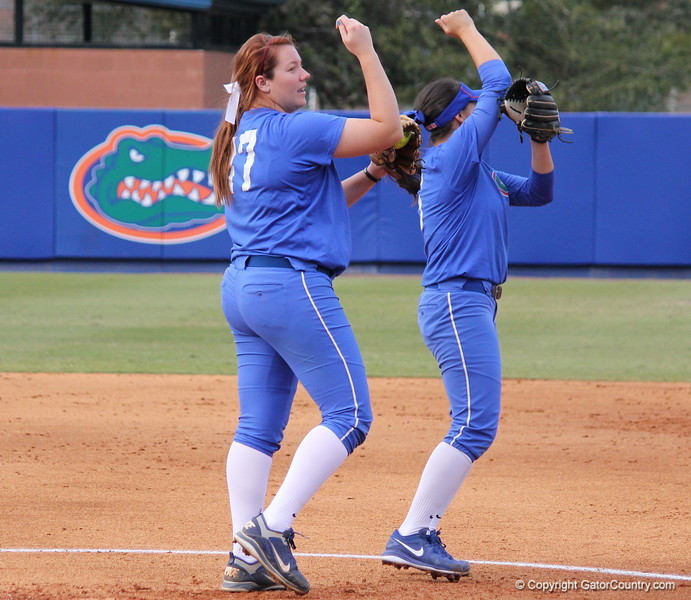 Sophomores Lauren Haeger and Kathlyn Medina perform a special handshake in between plays during the Gators' scrimmage on Tuesday, February 5, 2013 at Katie Seashole Pressly Stadium in Gainesville, Fla.