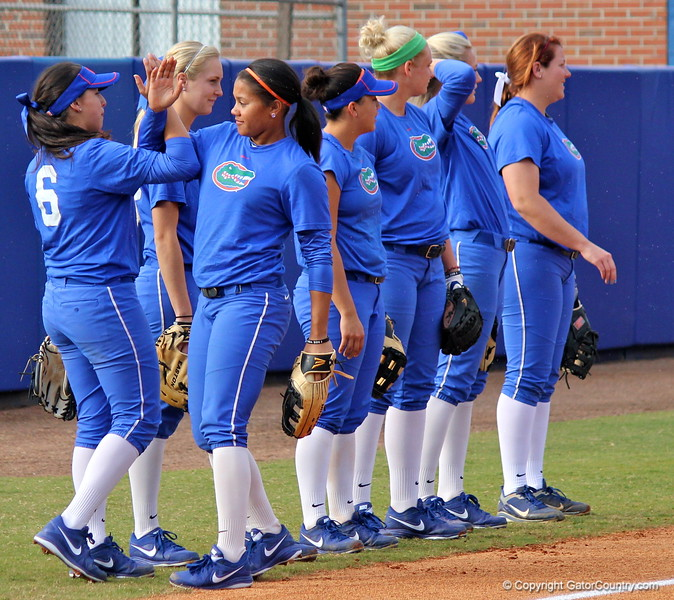 Sophomore Kathlyn Medina and Freshman Kelsey Stewart motivate each other while warming up during the Gators' scrimmage on Tuesday, February 5, 2013 at Katie Seashole Pressly Stadium in Gainesville, Fla.