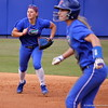 Sophomore Jessica Damico running to get the ball while freshman Kristi Merritt leaves first base during the Gators' scrimmage on Tuesday, February 5, 2013 at Katie Seashole Pressly Stadium in Gainesville, Fla.