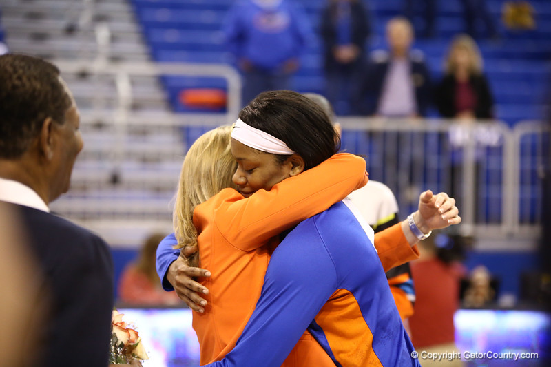 Jennifer George and Coach Amanda Butler hug during senior night during Florida's 69-58 win over Arkansas on February 28, 2013 at the Stephen C O'Connell Center in Gainesville, Florida.