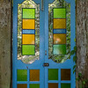 Colorful doors on a path at the Tropical Spice Garden