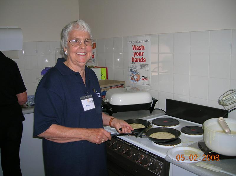 Margaret Cheffirs committee member  making pancakes