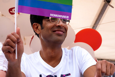 MP Kamal Qureshi waving with af flag from the gay porn shop, Homoware. I wonder if he knows what Homoware is.