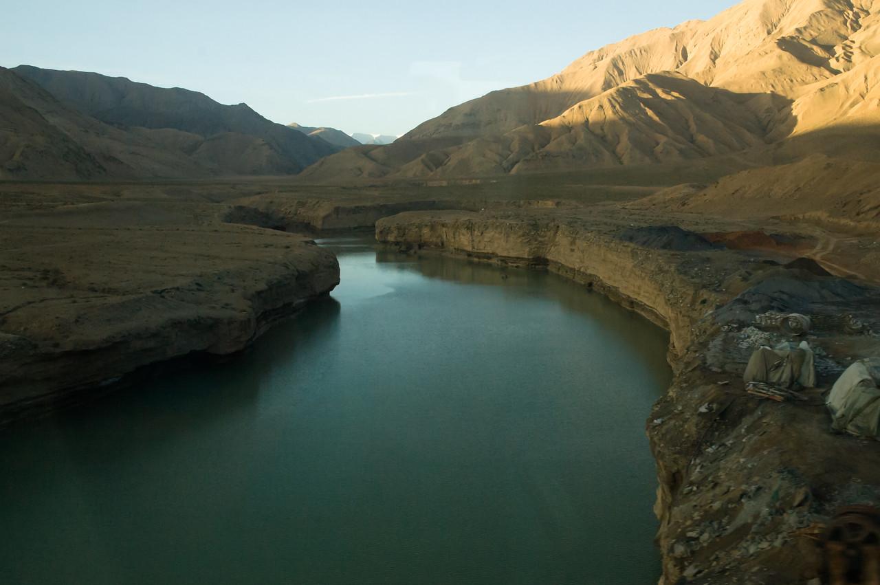 Tibetan river from the sky train by Josephine Jardine