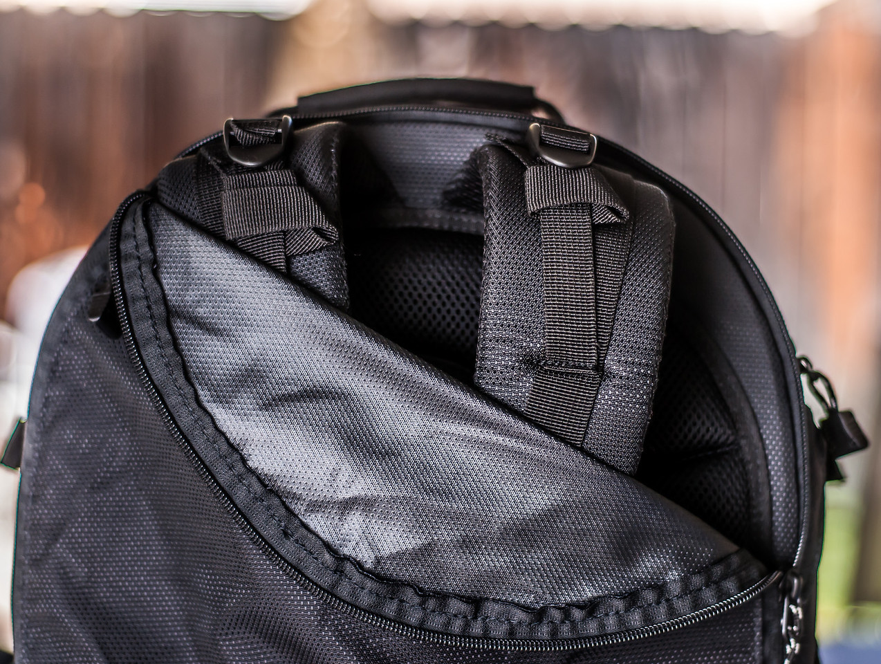"<br><br><a href=""http://www.tenba.com/Products/Shootout-Backpack-Medium-Black.aspx"" target=""_blank"">Tenba Shootout Backpack, Medium Black  <p>Detailed view of panel to conceal straps.</p></a>"