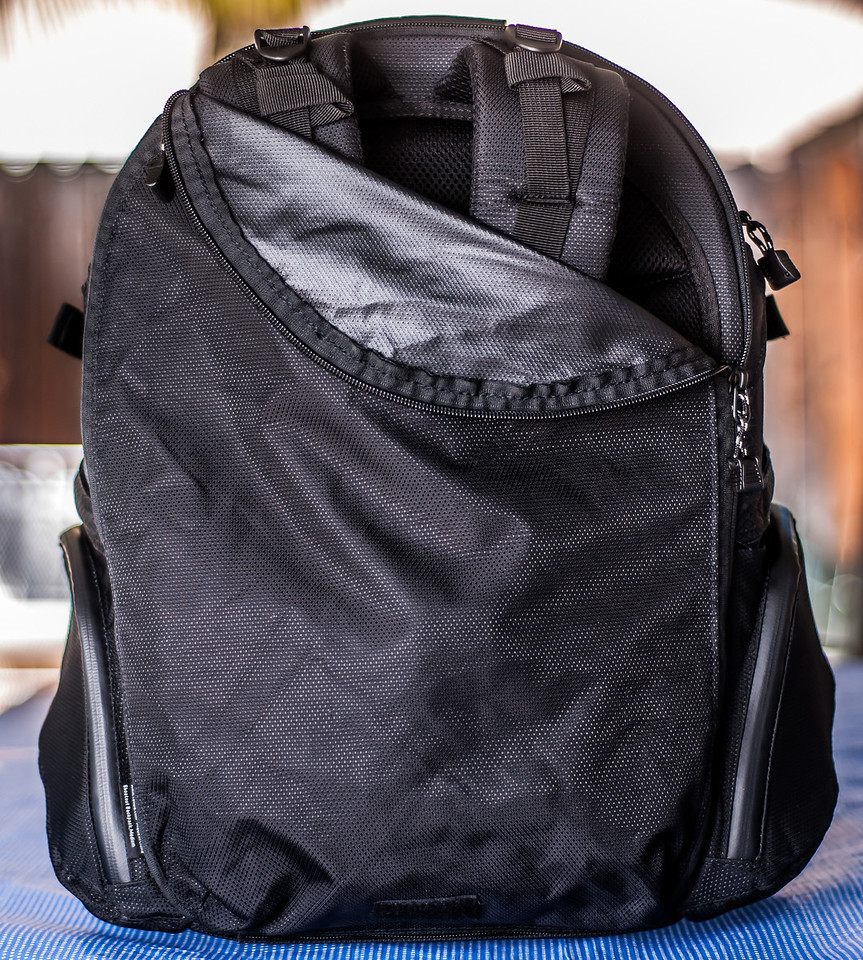"<br><br><a href=""http://www.tenba.com/Products/Shootout-Backpack-Medium-Black.aspx"" target=""_blank"">Tenba Shootout Backpack, Medium Black  <p>The Tenba backpack comes with a zippered panel to conceal the shoulder straps when they're not needed. Convenient when stowing in an overhead compartment on an airplane.</p></a>"