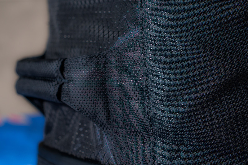 "<center> <br><br><a href=""http://www.tenba.com/Products/Shootout-Backpack-Medium-Black.aspx"" target=""_blank"">Tenba Shootout Backpack, Medium Black  <p>Strong top mount handle.</p></a> </center>"
