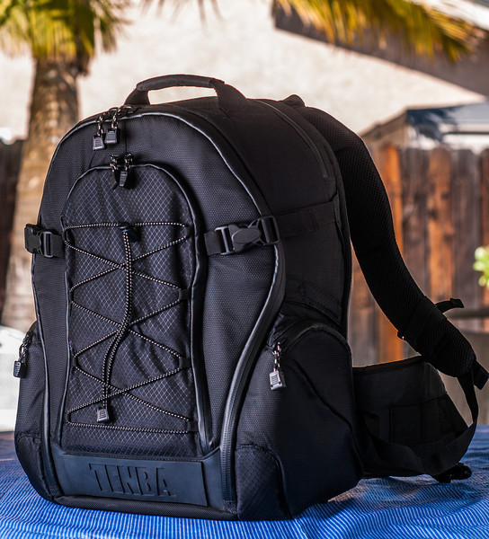 """<br><br><a href=""""http://www.tenba.com/Products/Shootout-Backpack-Medium-Black.aspx"""" target=""""_blank""""> Tenba Shootout Backpack, Medium Black <p><font>Three quarter view with removable waist belt attached.  </font></p></a>"""