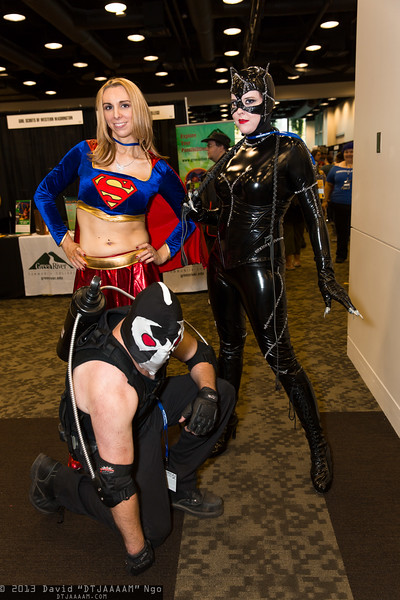 Supergirl, Bane, and Catwoman