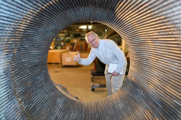 Alan Boyle peers through an Apollo F-1 engine - Museum of Flight