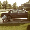 Dad washing the car sometime before the basketball hoop went up.