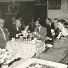 G1765 <br /> De opening van de Sociale Werkplaats door J.P. van Praag. We zien o.a. links dhr. Vogelaar, daarnaast burgemeester jhr. mr. R. Sandberg van Boelens, in gesprek met dhr. Van Praag. Foto: 1956.