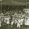 G1834 <br /> Het eeuwfeest 1813-1913, het onafhankelijkheidsfeest. Schoolkinderen bij het muziekpodium op het feestterrein bij de Overplaats. Foto: 1913.