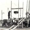 G1840 <br /> Tobbetje steken tijdens de Oranjefeesten in 1935. Links op de kar staat Chris van der Voort (zie F2388).