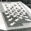 G1796 <br /> Mozaïek in de tuin van het gemeentehuis. De afbeelding is naar een bekende ets van M.C. Escher. Foto: 1954.